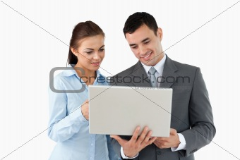 Business partners looking at laptop together