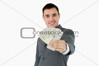 Smiling businessman presenting bank notes