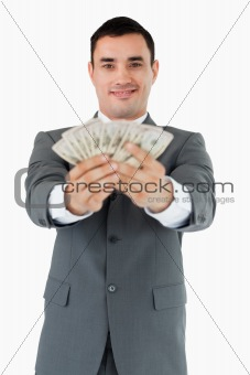 Smiling businessman presenting his bank notes