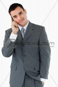 Smiling businessman ringing someone