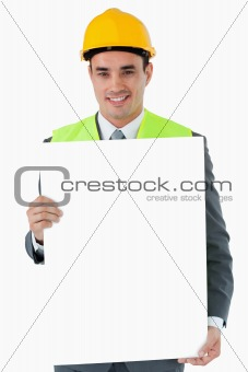 Smiling architect holding sign