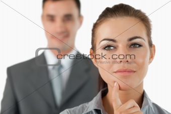 Close up of thoughtful businesswoman with colleague behind her