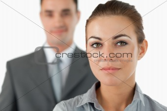 Close up of young businesswoman with colleague behind her