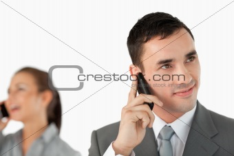 Close up of business partners talking on the cellphone