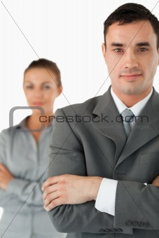 Close up of business partners with arms folded