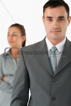 Close up of businessman with colleague behind him