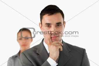 Close up of young businessman with colleague behind him