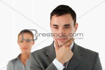 Close up of businessman in thoughts with colleague behind him