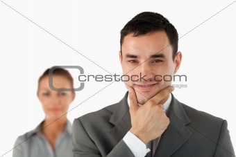 Close up of confident businessman with colleague behind him