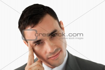 Close up of young businessman in thoughts