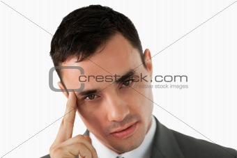 Close up of young businessman lost in thoughts