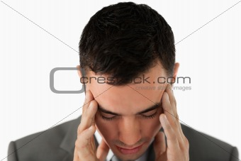 Close up of businessman having a headache
