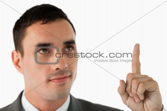 Close up of businessman pointing upwards