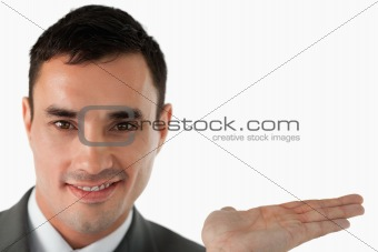 Close up of businessman presenting something in his palm