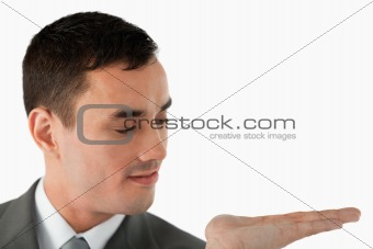 Close up of businessman looking at what he is presenting in his palm