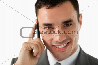 Close up of smiling businessman on his phone