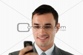 Close up of businessman reading a text message