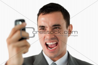 Close up of businessman upset about text message