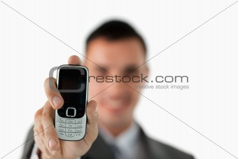 Close up of phone being shown by businessman