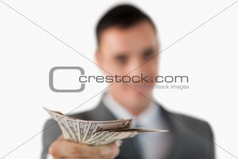 Close up of bank notes being held by businessman