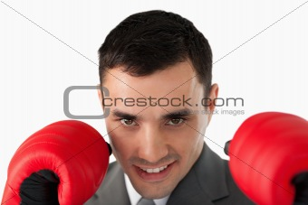 Close up of businessman with boxing gloves on