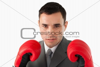 Close up of businessman wearing boxing gloves