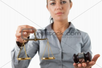 Scale and gavel being held by female lawyer