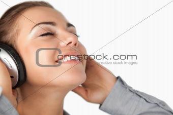 Close up of businesswoman enjoying music