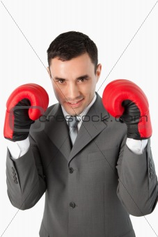 Close up of smiling businessman with boxing gloves on