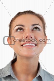 Portrait of businesswoman looking upwards