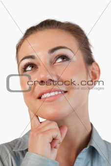 Close up of thinking businesswoman