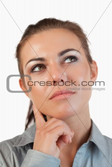 Close up of thinking young businesswoman