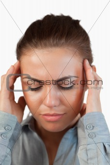 Close up of businesswoman suffering from a headache