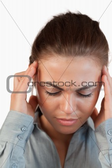 Close up of businesswoman having a headache
