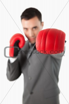 Close up of businessman's fist in a boxing glove