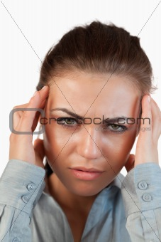 Close up of young businesswoman suffering from a headache