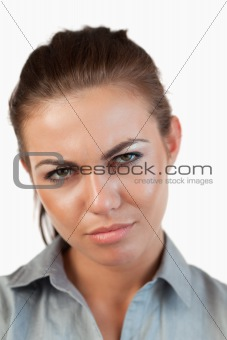 Close up of unhappy businesswoman