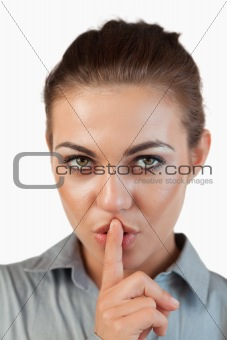 Close up of businesswoman asking for silence