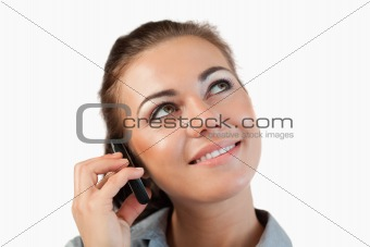 Close up of businesswoman on her phone looking diagonally upwards