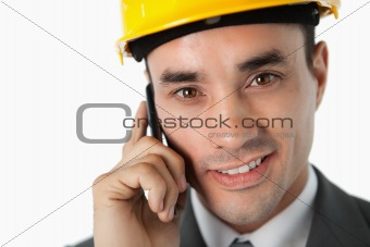 Close up of confident architect on the phone