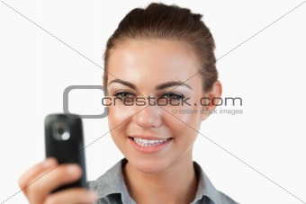 Close up of smiling businesswoman reading a text message