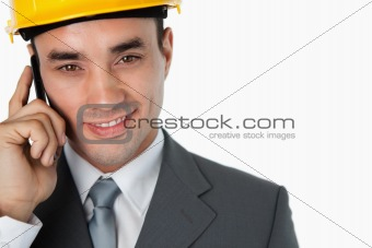 Close up of confident smiling architect on the phone