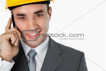 Close up of architect calling customer