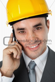Close up of smiling architect talking on the phone