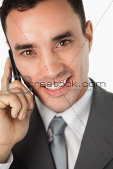 Close up of smiling young businessman on the phone