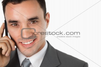Close up of happy businessman on his phone