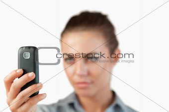 Close up of cellphone being held by businesswoman