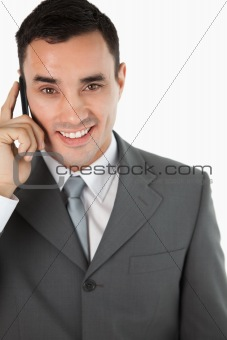 Close up of friendly smiling businessman on the phone