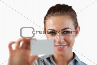 Close up of businesswoman showing her business card