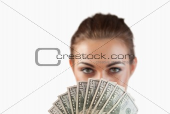 Close up of bank notes being held by businesswoman